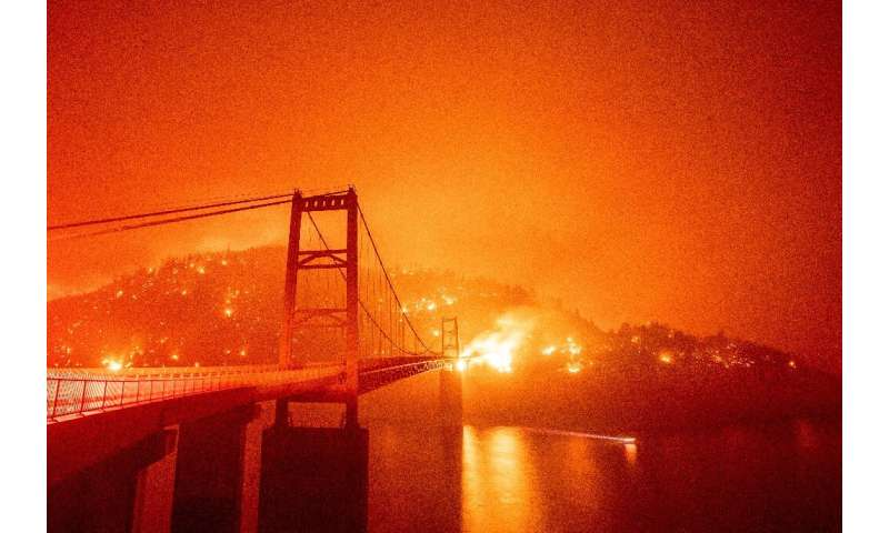 The Bidwell Bar Bridge is surrounded by fire in Lake Oroville during the Bear Fire in Oroville, California