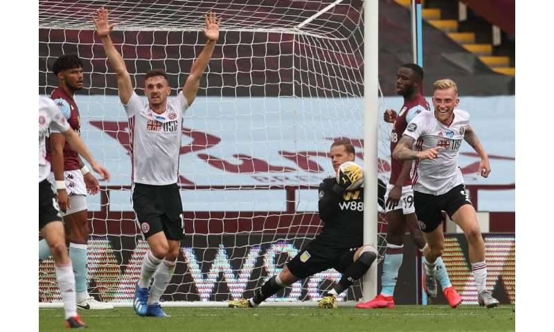 The English Premier League resumed after a 100-day shutdown when Aston Villa hosted Sheffield United at an empty Villa Park