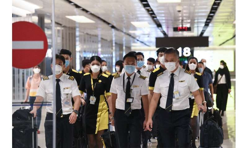 The flight crew of the chartered Scoot airline that flew to Wuhan to evacuate Singaporean nationals, arrives at Changi internati