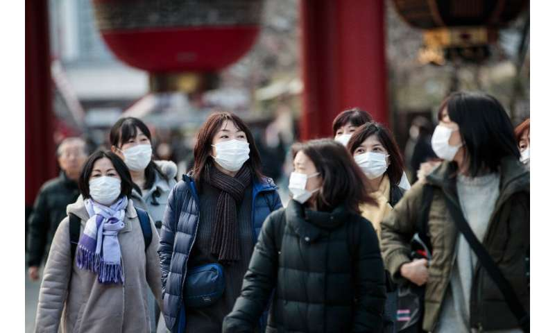 The health ministry said as of Monday that 20 people in Japan have tested positive for the new virus, of whom four showed no sym