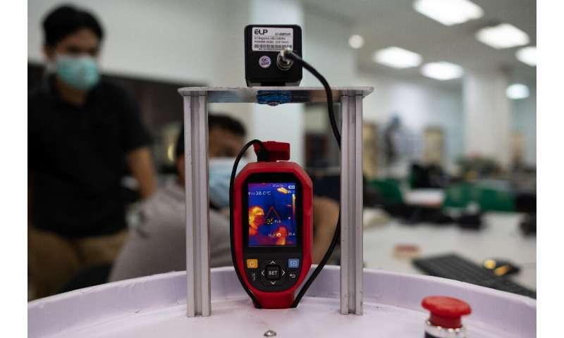 The invention is also fitted with a device to check patients' temperatures remotely