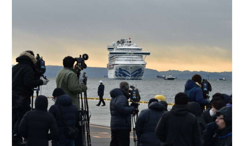 The media keep watch on the Diamond Princess cruise ship with over 3,000 people on board as it sits in quarantine at Yokohama po