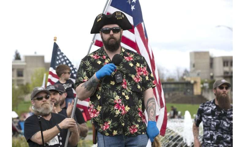 """The """"Boogaloo"""" movement (supporters pictured April 2020 in Olympia, Washington), which has adopted Hawaiian shirts as"""