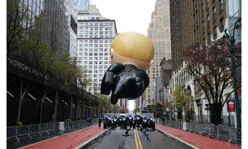 """The """"Boss Baby"""" balloon floats during an uncharacteristically subdued Macy's Thanksgiving Day Parade in New York on No"""