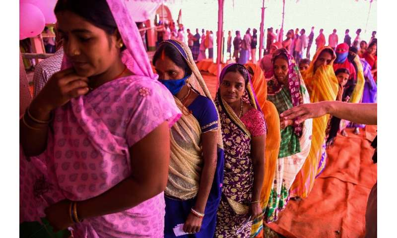 There was not much social distancing in evidence as voters bast their ballots for Bihar state assembly elections