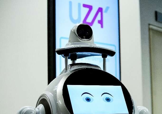 The robot takes temperatures and makes sure patients are wearing a mask correctly