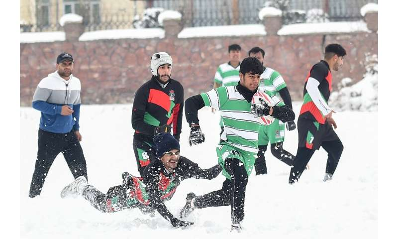 """The weather allowed these men to hold a """"snow rugby"""" tournament in Kabul, Afghanistan"""