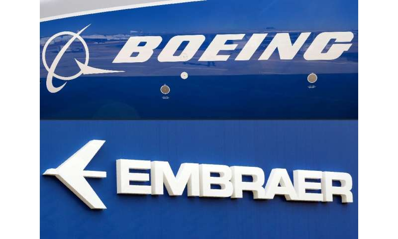 This combination of file pictures created on December 21, 2017 shows the Boeing logo on the fuselage of a Boeing 787-10 Dreamlin