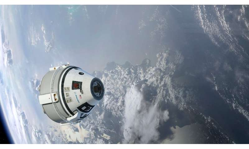 This NASA/Boeing handout image shows an artist concept of the CST-100 Starliner in Earth's orbit