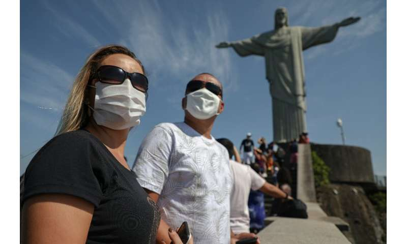 Tourists enjoy a visit to the Christ the Redeemer statue in Rio de Janeiro, Brazil, on August 15, 2020, during the reopening day