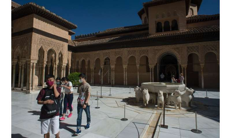 Tourists visit the Court of the Lions (Patio de los Leones) at the Alhambra in Granada on the day it reopened after three months