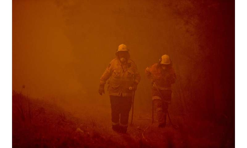 Towering bushfires in Australia have turned the sky red and forced thousands from their homes