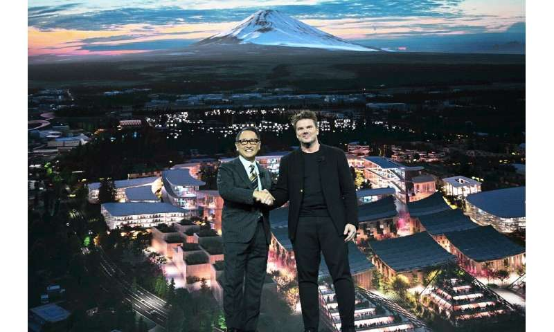 "Toyota President and CEO Akio Toyoda (L) and Danish architect Bjarke Ingel reveal plans for a prototype ""city"" of the"