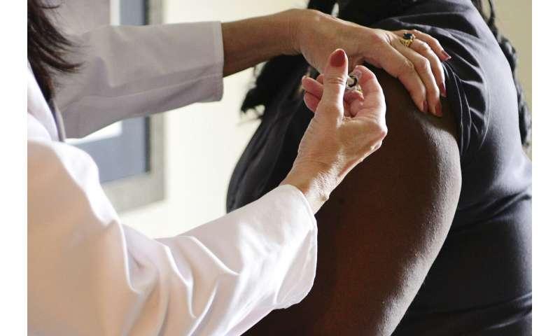 US panel tackles race, poverty in virus vaccine priorities