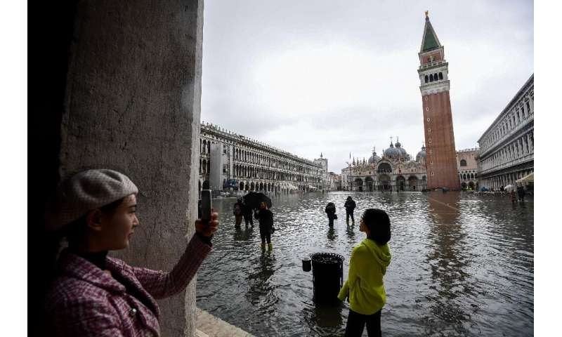 "Venice regularly experiences ""acqua alta"", abnormally high tides that flood shops and hotels as well as the famous St."