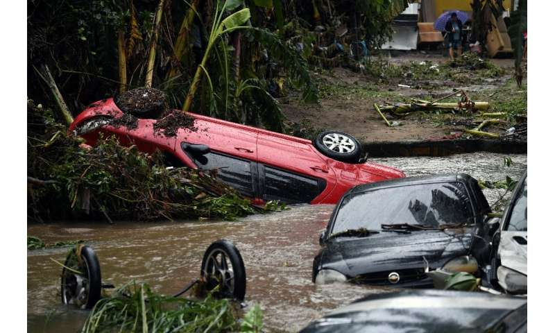 View of cars stuck in the water and mud, after heavy rains during the weekend in Realengo neighbourhood, in the suburbs of Rio d
