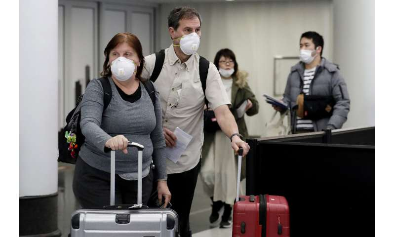 Virus hammers business travel as wary companies nix trips