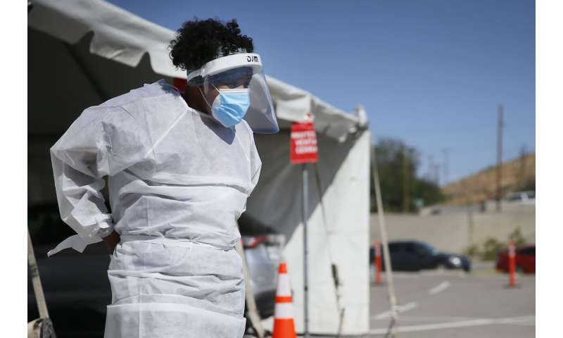 Virus surge breaking infection records across the US
