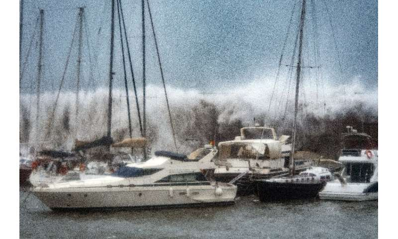 Waves broke over a sea wall at the Port Olympic marina in Barcelona as storm Gloria battered the Spanish eastern coast earlier t