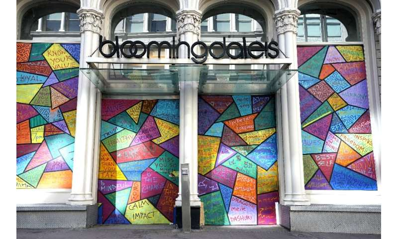 While some stores in New York reopened for curbside pick-up, Bloomingdale's remained boarded up in the wake of looting sparked b