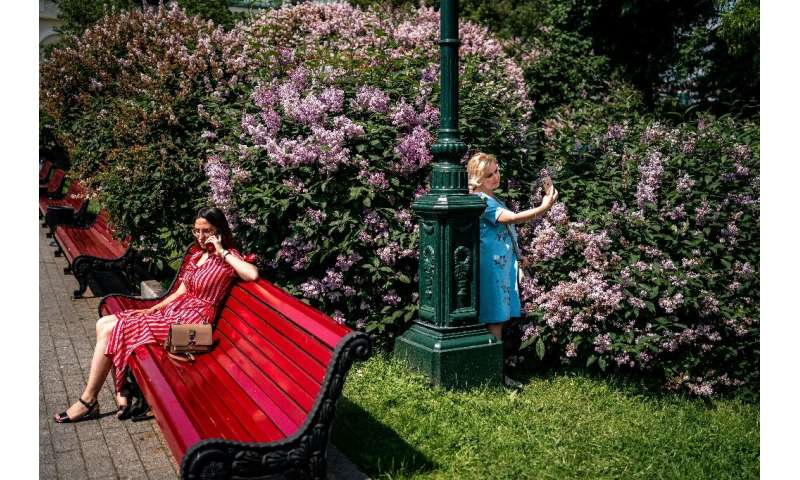 Women enjoy a warm and sunny day in a park in downtown Moscow on June 9, 2020, after officials lifted coronavirus restrictions