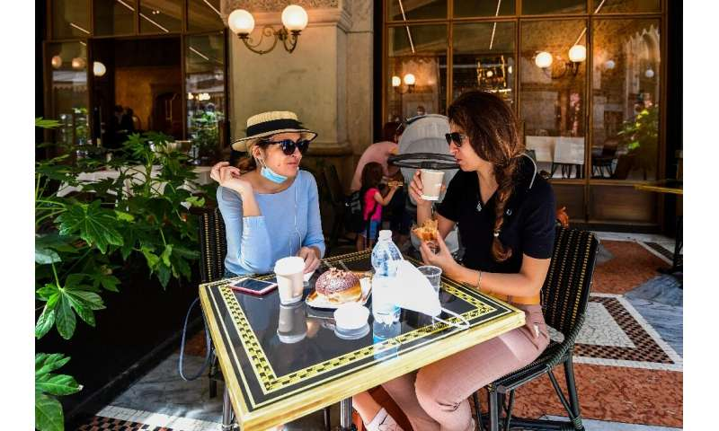 Women have coffee and pastry at Cafe Some Milan residents availed themselves of the chance to enjoy a coffee and pastry on a caf