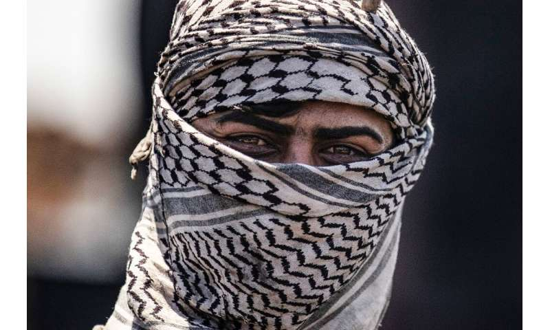Workers at informal refineries cover their faces with scarves, to provide a degree of protection against skin complaints and oth