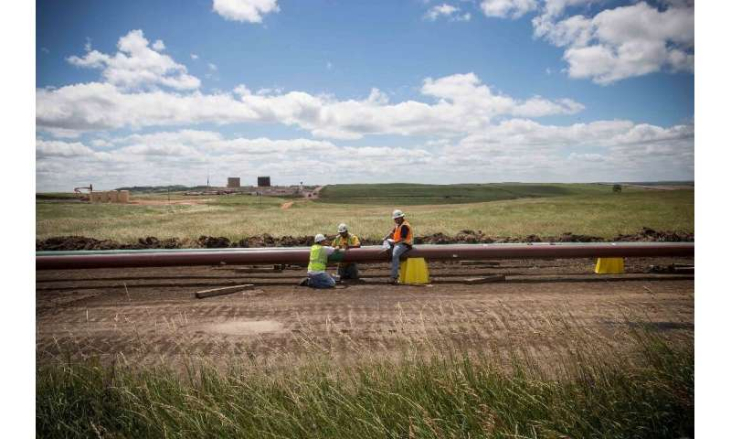 Workers build an oil pipeline in North Dakota in July 2013; the Trump adminstration is hoping to dilute environmental regulation