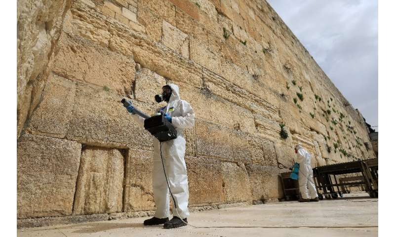 Workers sanitise the Western Wall, the most holy site where Jews can pray against the spread of the coronavirus COVID-19 in Jeru