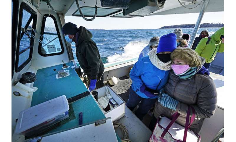 Boat, snowmobile, camel: Vaccine reaches world's far corners