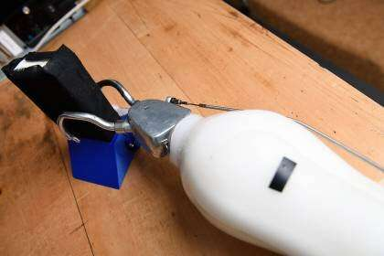 Get a grip: Adding haptics to prosthetic hands eases users' mental load