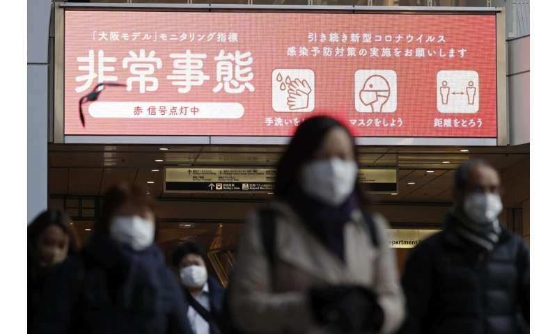 Japan widens virus emergency for 7 more areas as cases surge
