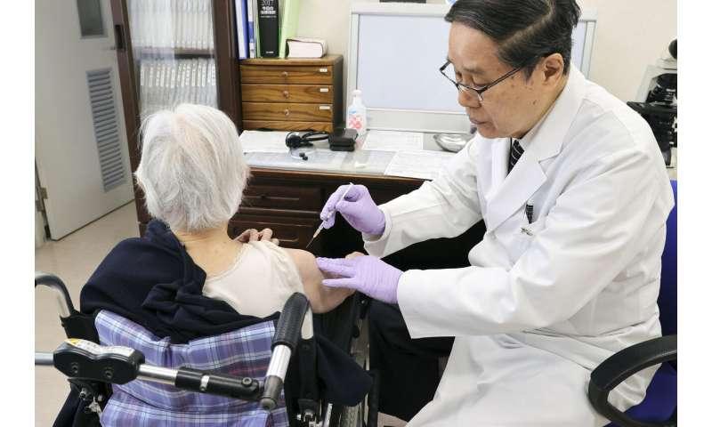 Tokyo adopts tougher virus rules, starts vaccinating elders