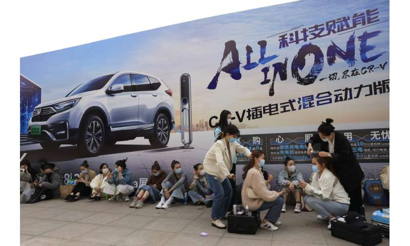 VW, Ford unveil SUVs at China auto show under virus controls