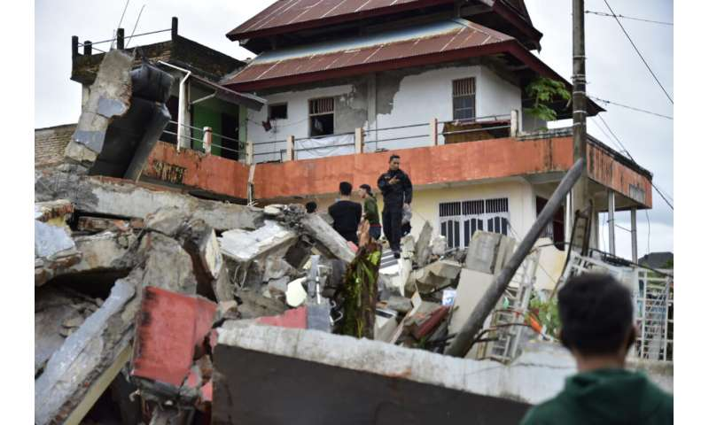 At least 34 dead as Indonesia quake topples homes, buildings