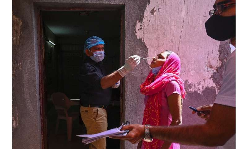 A medical worker performs a Covid test in Ghaziabad, India on April 3, 2021