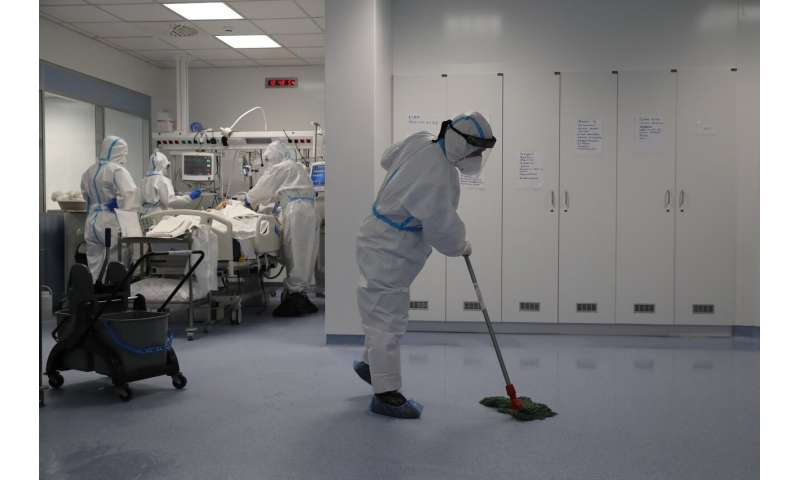 Out of sight, cleaners perform critical work in COVID ICUs