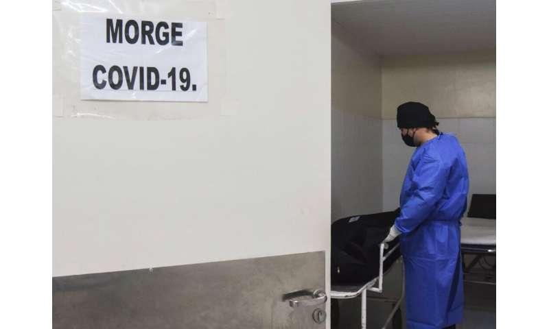 A healthworker at a morgue in Paraguay