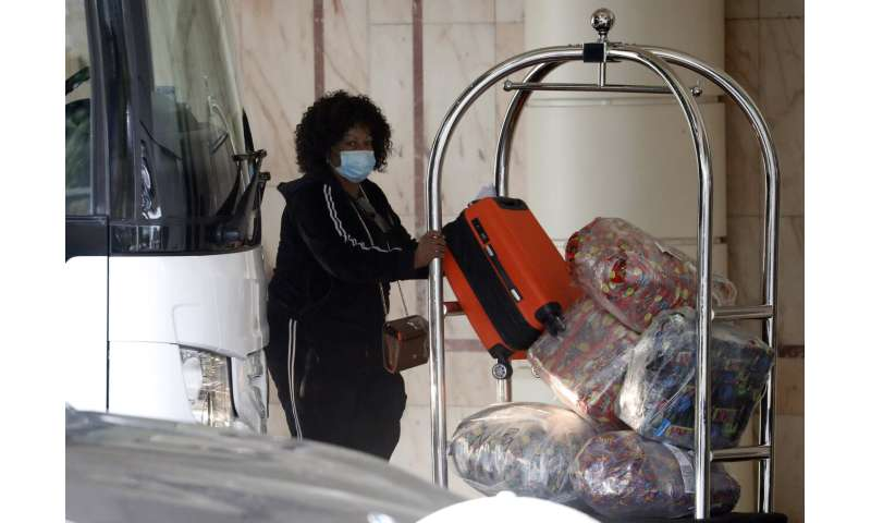 UK opens quarantine hotels, pushes on with vaccine drive