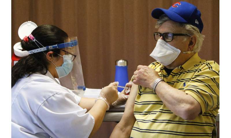 US asking states to speed vaccine, not hold back 2nd dose