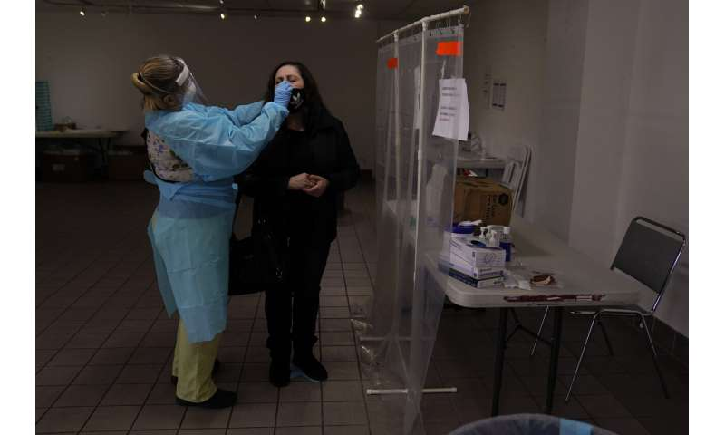 US virus deaths surpass 450K; daily toll is stubbornly high