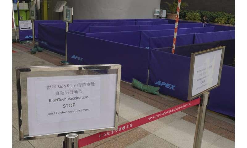Hong Kong halts use of Pfizer vaccine, cites defective lids