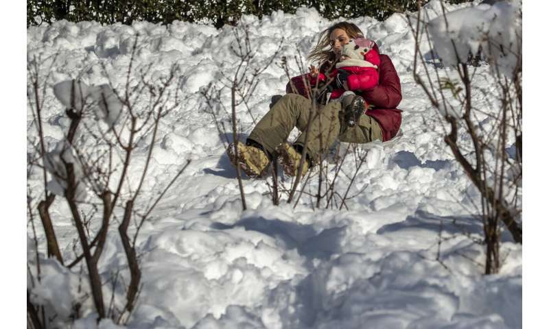 Spain shovels out of snowdrifts left by Storm Filomena