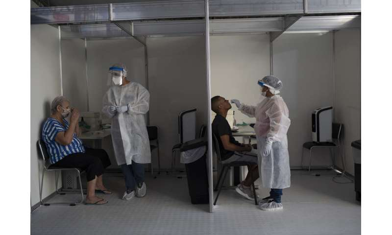 Countries worldwide hit new records for virus cases, deaths