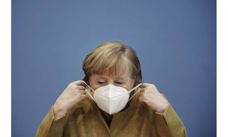 Germany's Merkel points to variant risk as infections drop