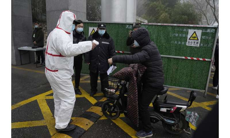 WHO team in Wuhan visits provincial disease control center
