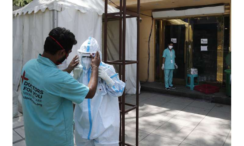 India's capital to lock down amid explosive virus surge