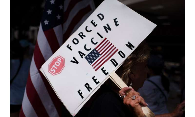 Anti-vaccine rally protesters hold signs outside of Houston Methodist Hospital in June 2021 - employees had sought to overturn a