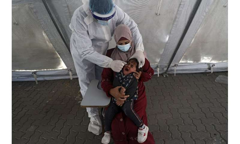 A Palestinian health worker administers a Covid test on April 1, 2021