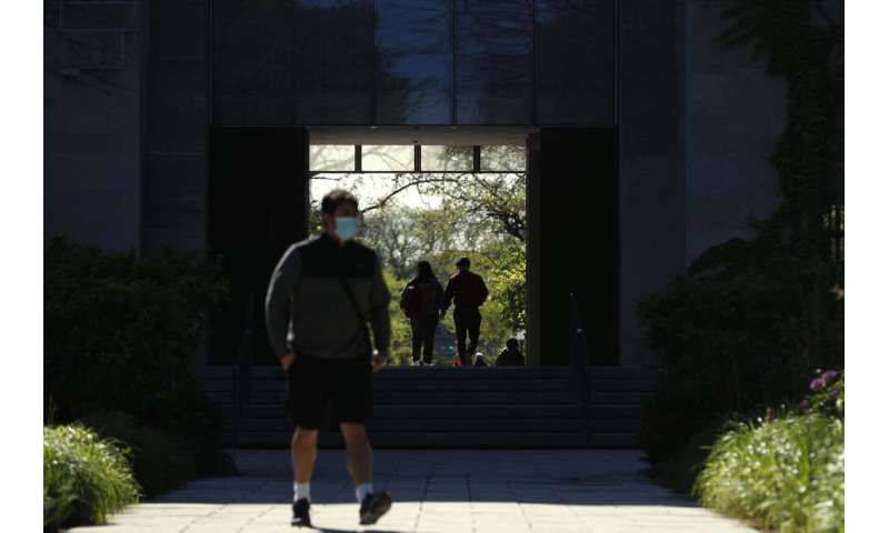 As US reopens, campuses tighten restrictions for virus